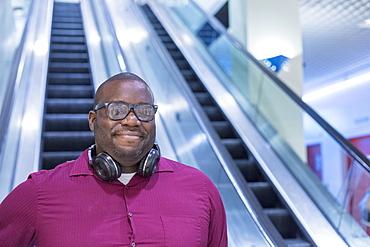 Man with ADHD on an escalator