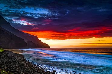 Sunset over Kalalau Beach, Na Pali Coast State Park; Kauai, Hawaii, United States of America