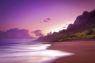 Pastel sunset sky over the rugged mountains along the Na Pali Coast, Kalalau Beach, Na Pali Coast State Park; Kauai, Hawaii, United States of America