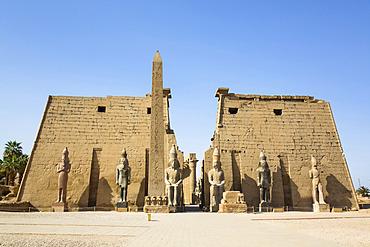 Six Colossi of Ramses II in front of Pylon, Obelisk, Luxor Temple, UNESCO World Heritage Site; Luxor, Egypt