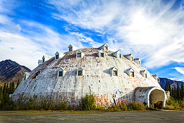 Abandoned Igloo City Hotel, and Igloo-shaped building at Igloo City along the George Parks Highway, Interior Alaska in summertime; Cantwell, Alaska, United States of America