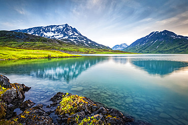 Mount Ascension reflects on Lost Lake, Chugach National Forest, Kenai Peninsula, South-central Alaska in summertime; Seward, Alaska, United States of America