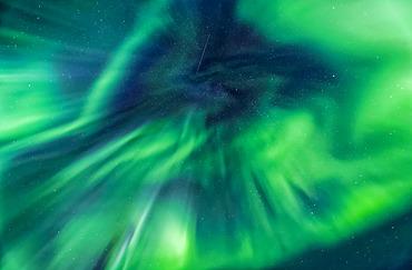 Corona aurora spreading in the sky, Taylor Highway, Interior Alaska in autumn; Alaska, United States of America