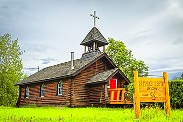 Historic log building of St. Mark's Episcopal Church, Interior Alaska in summertime; Nenana, Alaska, United States of America