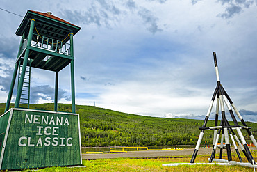 Display of Nenana Ice Classic tripod for 2016 and tower by Tanana River, Interior Alaska in summertime; Nenana, Alaska, United States of America