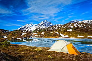 Camping at Lost Lake, Resurrection Peaks in the background. Chugach National Forest, Kenai Peninsula, South-central Alaska in springtime; Seward, Alaska, United States of America
