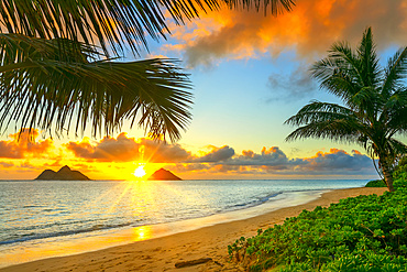Sunrise viewed from Lanikai Beach with a view of the Mokulua Islands off the coast; Oahu, Hawaii, United States of America
