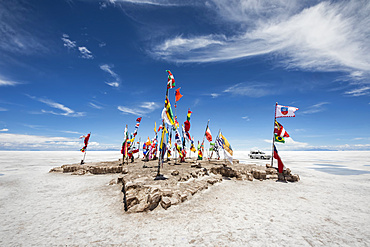 Flags of countries participating in the Bolivia Dakar Rally on Salar de Uyuni, the world's largest salt flat; Potosi Department, Bolivia