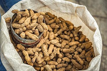 Peanuts for sale in a sack with a metal scoop; San Cristobal de las Casas, Chiapas, Mexico