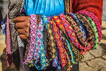 Indigenous woman selling handicrafts; San Cristobal de las Casas, Chiapas, Mexico