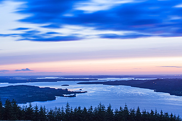 Dawn over Lough Derg with trees in the foreground, long exposure; County Clare, Ireland