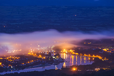 The twin towns of Ballina and Killaloe at night on the River Shannon with fog hanging over the towns; Killaloe, County Clare, Ireland