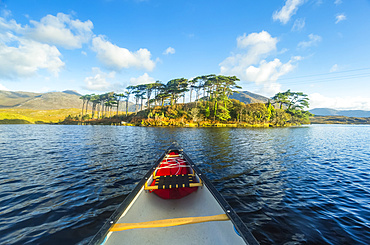 Front of a canoe on Derryclare Lough pointing towards Pine Island on a sunny day; Connemara, Galway, Ireland