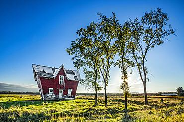Fun house on the prairies with blue sky, near Sault St. Marie; Ontario, Canada