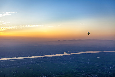 Hot air balloon over the Nile at dawn; Luxor, Egypt