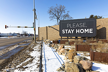 Roadside sign saying 'Please Stay Home' during the isolation of Covid-19 world pandemic; St. Albert, Alberta, Canada