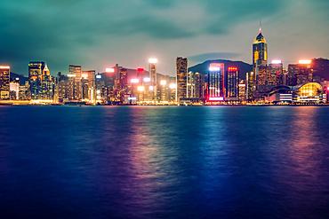 Long exposure at twilight of Hong Kong skyscrapers taken from Tsim Tsa Tsui; Hong Kong, Hong Kong Special Administrative Region (SAR), Hong Kong