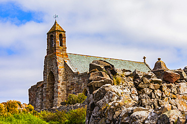 A view of the exterior and bell tower of the Lindisfarne Priory on Holy Island: Northumberland, England