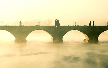 Early morning mist around Charles Bridge on the Vltava river; Prague, Czech Republic