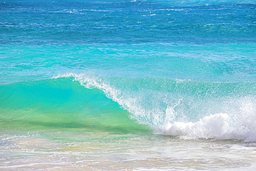 Splashing waves along the shore of white sand; Oahu, Hawaii, United States of America