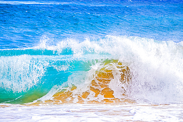 Splashing waves along the shore of sand; Oahu, Hawaii, United States of America