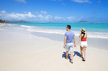 An Asian couple enjoying a vacation at Kailua Beach Park: Kailua, Oahu, Hawaii, United States of America