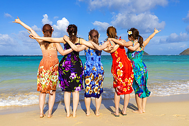 A group of Japanese students on vacation at Lanakai Beach with the Mokes Islands in the background: Oahu, Hawaii, United States of America