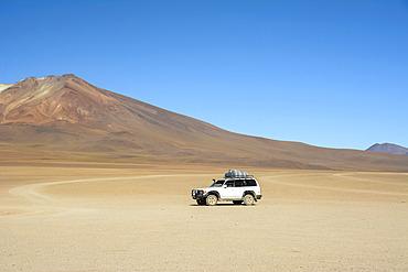 An expedition 4x4 truck in the high altitude desert of Bolivia; Potosi, Sur Lipez, Bolivia