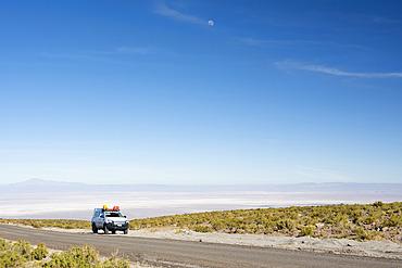 A 4x4 expedition truck is parked along a high altitude road over the desert; San Pedro de Atacama, Atacama, Chile