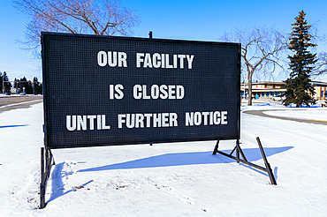 A sign indicating facility closures during the COVID-19 World Pandemic; Edmonton, Alberta, Canada