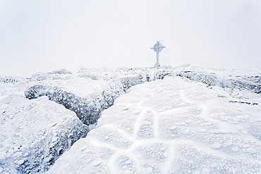 Frozen ice formations on the summit of Galtymor mountain with a celtic cross in winter, Galty Mountains; County Tipperary, Ireland