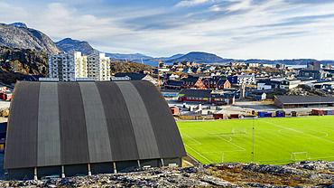 A sports field and structure with a view of a neighbourhood and mountains; Nuuk, Sermersooq, Greenland