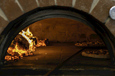 Two pizzas in a wood-fired pizza oven; Melbourne, Victoria, Australia