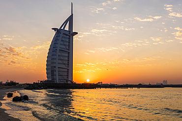 Sunset behind Burj Al Arab; Dubai, United Arab Emirates