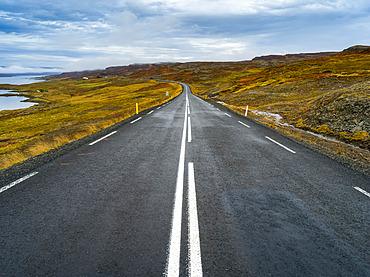 Paved road running along the coastline of Northwestern Iceland; Hunaping vestra, Northwestern Region, Iceland