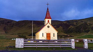 A church with tower in a remote seaside village in South Iceland; Iceland