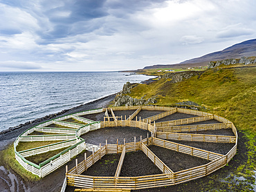 A circular farming structure a animal enclosures along the coast; Hunaping vestra, Northwestern Region, Iceland