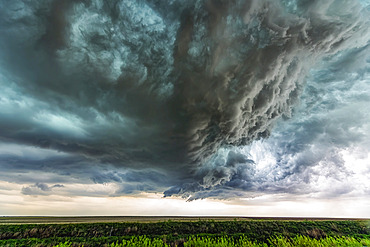 Supercell thunderstorm clouds show off the power of mother nature. Massive clouds build and unleash powerful storms creating a beautiful and awe inspiring spectacle; Colorado, United States of America
