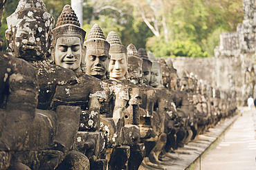 Statues at South gate to Bayon temple, Angkor Wat complex; Siem Reap, Cambodia