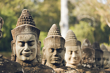 Head sculptures at South gate to Bayon temple, Angkor Wat complex; Siem Reap, Cambodia