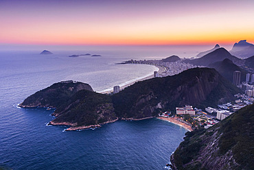 Glowing sunset over the Atlantic ocean and the coastline of hills and beaches of Rio de Janeiro; Rio de Janeiro, Rio de Janeiro, Brazil