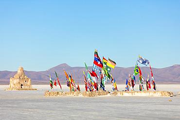 Flags of the world at the entrance of Salar de Uyuni; Potosi, Bolivia