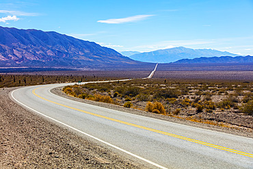 Road going through the arid and mountainous landscape of Los Cardones National Park; Salta Province, Argentina
