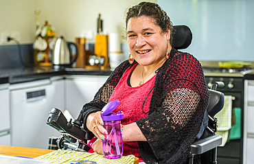 Maori woman with Cerebral Palsy in a wheelchair; Wellington, New Zealand