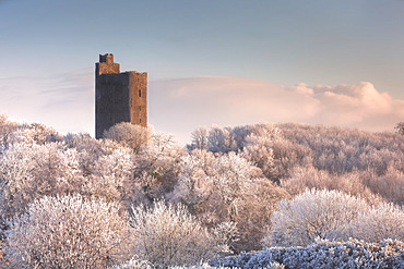 Kilworth Castle, an old Castle ruins overlooking a snow-covered forest in winter at sunrise; Kilworth, County Cork, Ireland