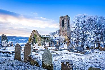 Shanrahan Church, an old church ruins and graveyard covered in snow at sunrise; Adrfinnan, County Tipperary, Ireland