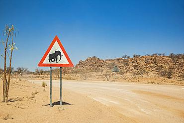 Elephants warning sign on a roadside, on the road to Brandberg Mountain, Damaraland; Kunene Region, Namibia