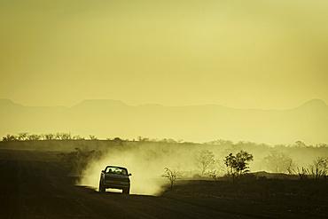 Driving at sunset, Damaraland; Kunene Region, Namibia