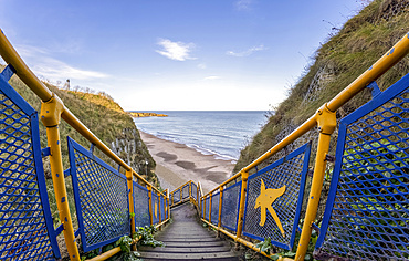 Steps with colourful railing leading down to the beach, Marsden Bay; South Shields, Tyne and Wear, England
