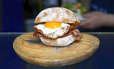 Fried egg breakfast sandwich; London, England